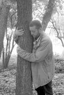 Sebastian Theves embracing a tree on fieldsite.